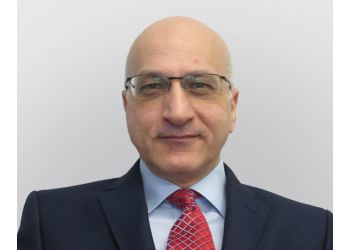 Dr. Ali Juma, MB BS (Lon), FRCS (Ed), FRCS (Plast) (Ed)