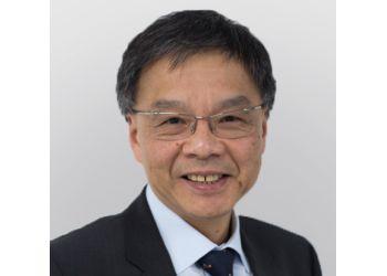 Dr. Ivan T. H. Foo, MBBS (London), FRCS (Eng), FRCS (Ed), FRCS(Plast)