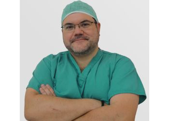 Dr. THOMAS CHAPMAN, BSc, MBChB, MRCS, FRCS (Plast)