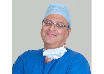Dr. Tariq Ahmad, MA, FRCS(PLAST)