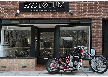 Factotum body modification Studio