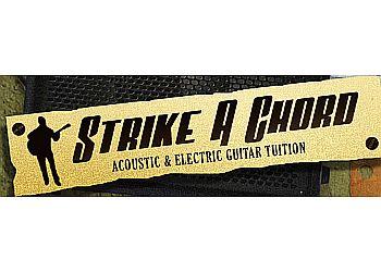 Strike A Chord - Guitar Tuition