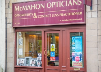 T. A. McMAHON OPTOMETRISTS